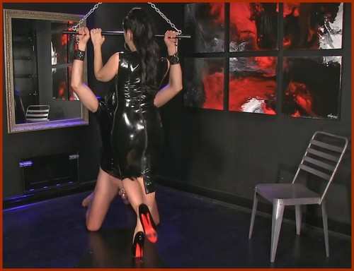femdom woman in fetish dress