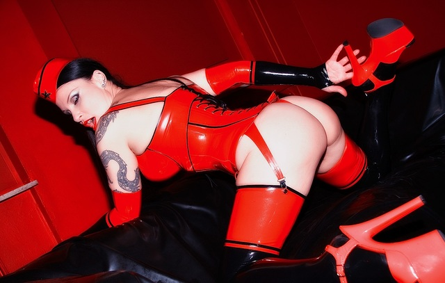 girl in red latex corset