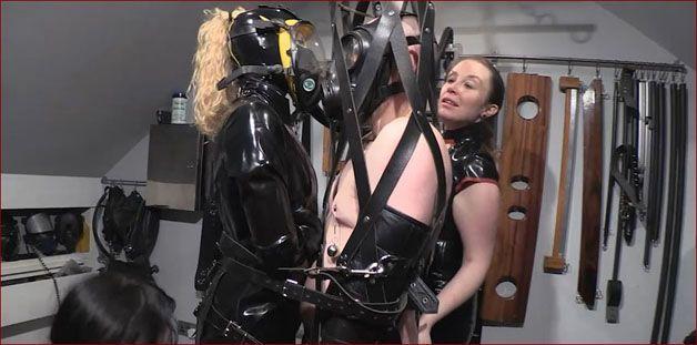 Hard bondage in leather mesh in fetish clip