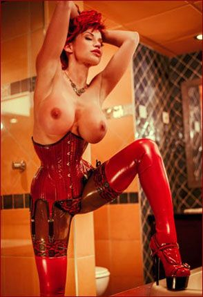 ILOVEBIANCA - Bianca Beauchamp - Heavy latex corset on redheaded prankster [JPEG 2002x3000]