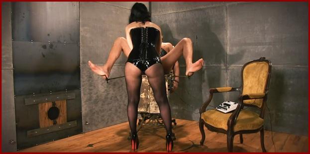 woman black rubber corset