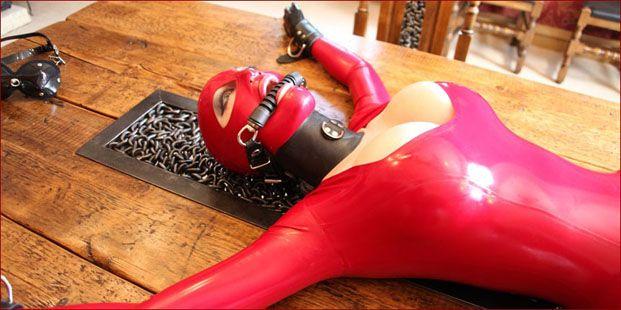 bondage rubber lady on table