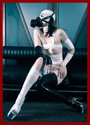 KinkyStyle - Dutch Dame - Bondage in bandages with gas mask on face | JPEG 1200x900