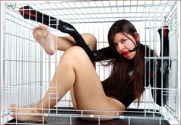 Keiko - Girl in a straitjacket sits in steel cage [JPEG 1200x900]