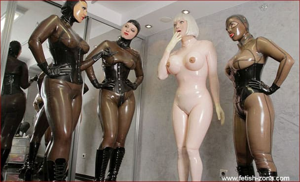 Sissy rubberdoll captured by three ladies [JPEG 1200x800]
