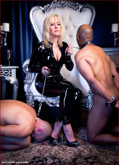 Mistress Tess in latex and her slaves - JPEG 833x1250